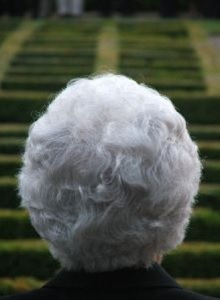 older woman facing a staircase