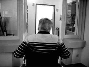 older man sitting in room