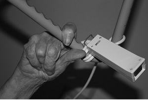 older person's hand within nursing home