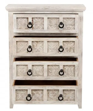 White wooden dresser with black handles on the drawers