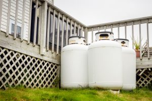 Group of propane cylinders in the backyard of a house