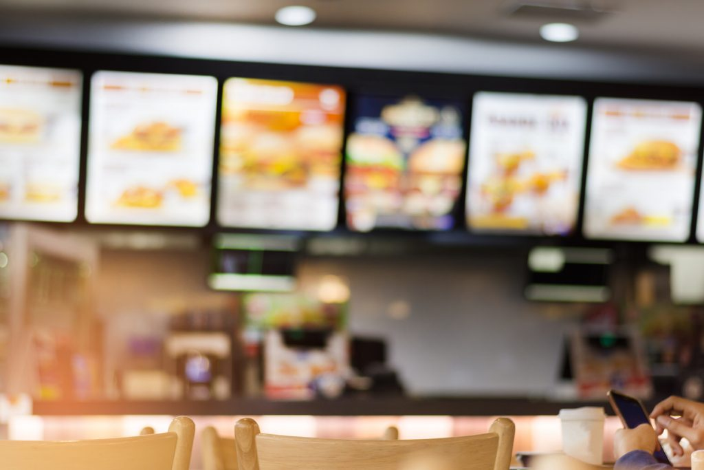 Blur image of fast food restaurant, use for defocused background.