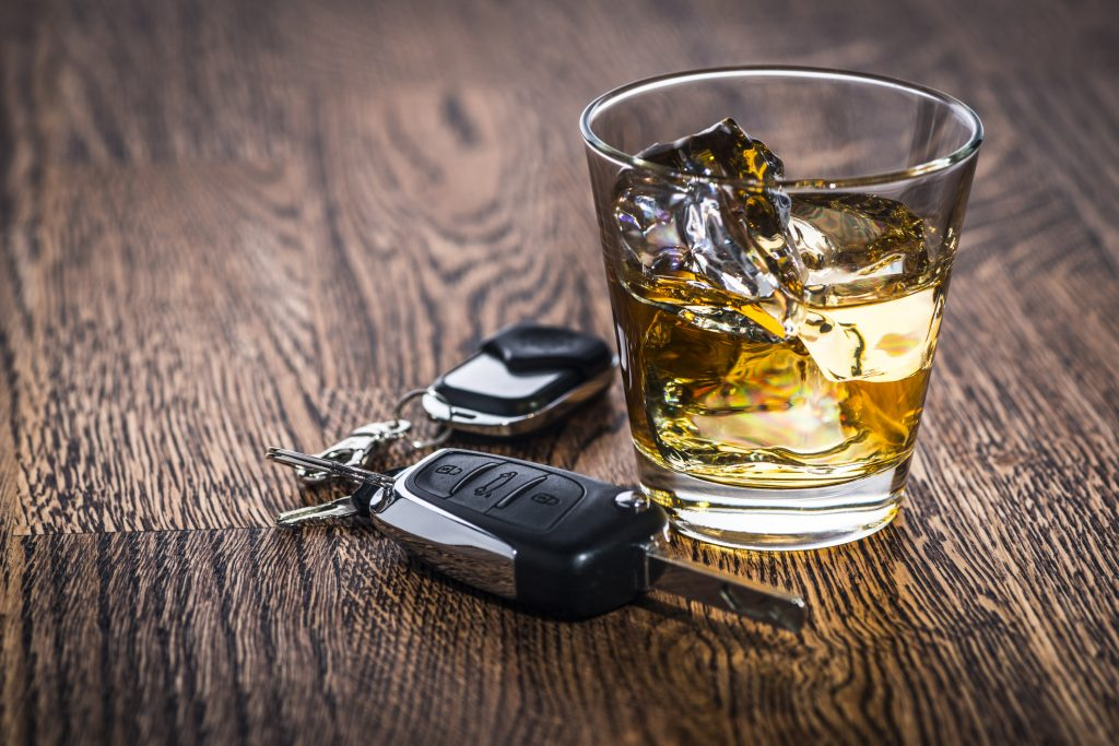 Car keys next to an alcoholic drink